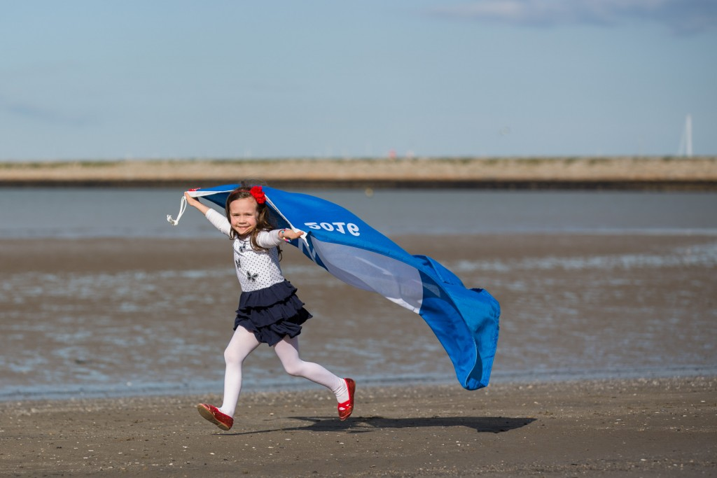"Embargoed until 12 noon Thursday 26th May 2016 No repro Fee 26-5-2016 **Coastal Awards Recognise Ireland's Best Beaches and Marinas** Picture shows Caoimhe Culhane (5) celebrating An Taisce's Blue Flag Awards 2016 at Seapoint,Co Dublin.Pic:Naoise Culhane-no fee 85 International Blue Flag and 56 National Green Coast Awards for Ireland Today, An Taisce announced the International Blue Flag Award and the National Green Coast Award recipients for the 2016 bathing season. A total of 141 awards were presented by the Minister for the Environment, Community and Local Government, Mr. Simon Coveney, T.D, at an awards ceremony held on the Velvet Strand, Portmarnock in Fingal at 12 noon today. Speaking at the awards Minister Coveney noted that ""In Ireland, we are particularly fortunate to have a varied and beautiful coastline with many pristine beaches that are open to the public to enjoy. However, we cannot rest on our laurels and must continue to make strident efforts to protect and improve our waters. This will ensure that we, and future generations, can continue to enjoy this wonderful resource."" Mr. Ian Diamond, Coastal Awards Manager at An Taisce's Environmental Education Unit speaking at the awards said: ""I would like on behalf of An Taisce to pay tribute to the Local Authorities and marina operators here today for all their efforts in ensuring that the sites being awarded for the 2016 bathing season have achieved the excellent standards required by the Blue Flag and Green Coast Awards"". The 79 Irish beaches and 6 marinas are awarded the prestigious Blue Flag Award for the 2016 bathing Season. The Blue Flag is one of the world's most recognised eco-labels. The programme aims to raise environmental awareness and promote sound environmental practices and behaviours among beach and marina users. The 79 Irish beaches and 6 marinas that achieved this accolade met a specific set of criteria related to water quality, information provision, environmental educ"