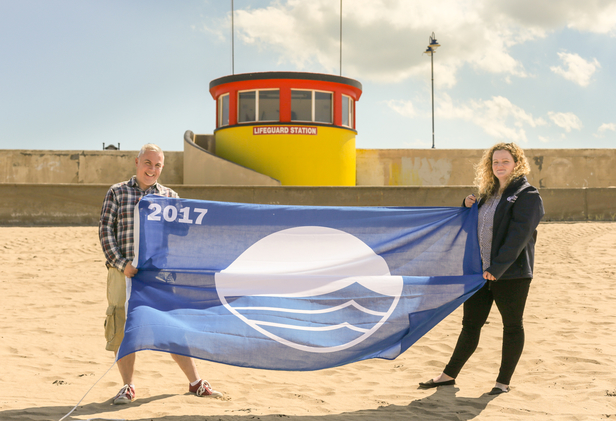 This year's Blue Flag is delivered to Bundoran Tourism Officer by Beckey-Finn Britton, An Taisce Coastal Programmes Development Officer for Donegal - Pic Conor Conlon CMP Productions