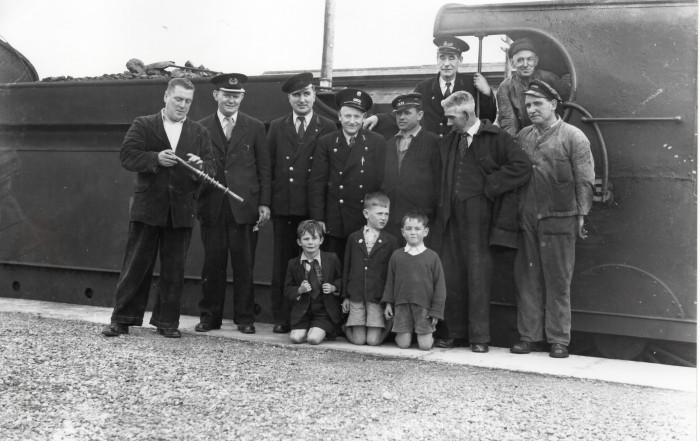 Members of staff of the Great Northern Railway in Bundoran pose for a photo with some local children at Bundoran station on Monday 30th September 1957