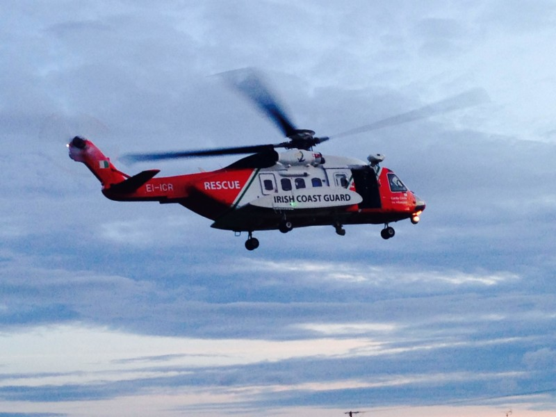 Photo shows Irish Coast Guard helicopter Rescue 118 in the air above Bundoran